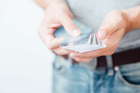 electronic money transactions. man holding assortment of credit cards. Stock Photo