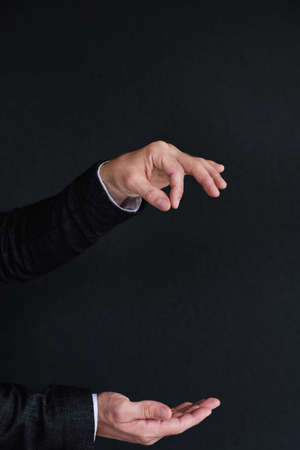 man hands holding virtual object on invisible string. empty space for advertisement. Stock Photo