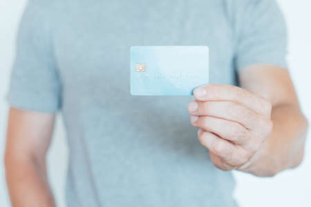 credit card online transactions and banking. money management and finances. man holding plastic card.