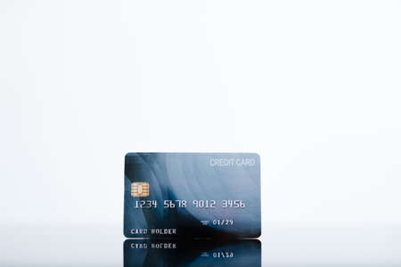 credit card on white background. banking operations and electronic money concept.