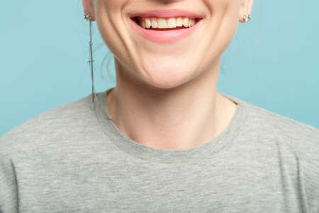 woman smile. happy emotional female lips and chin. cropped portrait.