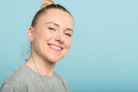 smiling joyful happy woman. emotional portrait on blue background.