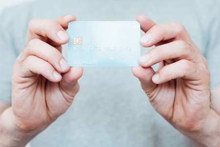 convenient shopping with credit card. easy checkout and money management. man holding plastic card. Stock Photo