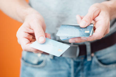 online payments with credit card. personal finances and money management. man holding plastic bank card. Stock Photo