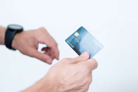nfc and digital payment. online money transactions. man holding credit card. Stock Photo