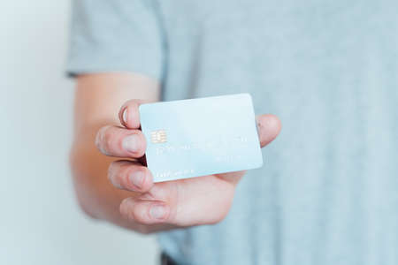 secure shopping with credit card. easy checkout and money management. man holding plastic card.