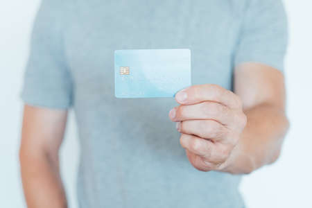 secure online payments with credit card. financial safety and bank account management. man holding plastic card.