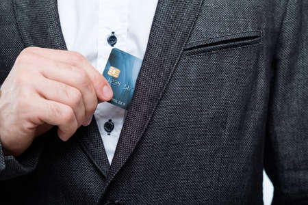 shopping with credit card. easy checkout and money management. business man taking out plastic card from pocket.