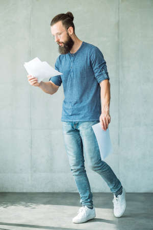 man reading documents. legal agreement contract and business paperwork concept.