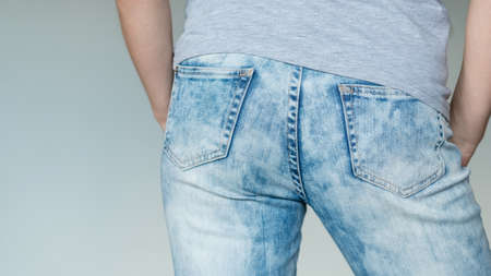 man butt in jeans. nice buttocks in blue denim. male fashion Фото со стока