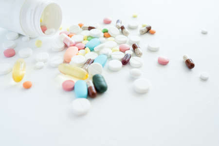 pills mix. healthcare and disease treatment. scattered multicolor drugs on white background
