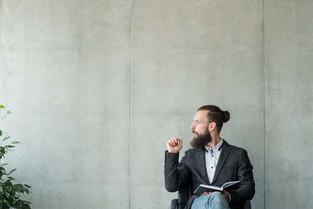 man looking sideways to empty space. business workshop or career coach. Stock Photo