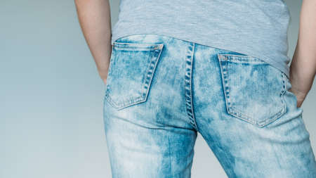 female butt in jeans. seductive shape in blue denim. backview