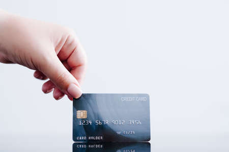 online payments made easy with credit card. personal finances and money management. hand holding bank card. Stock Photo