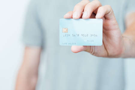 secure online payments with credit card. personal finances and bank account management. man holding plastic card.