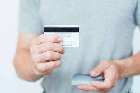 credit card CVV2 code. online payments security. man holding plastic cards.