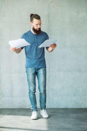 focused man reading or studying business documents. information analysis and paperwork Banco de Imagens