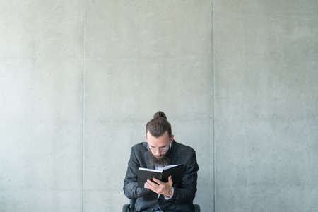 man focused on reading. bookworm knowledge learning
