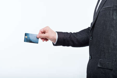 shopping with credit card. easy checkout and electronic payment. man hand holding plastic card. Stock Photo