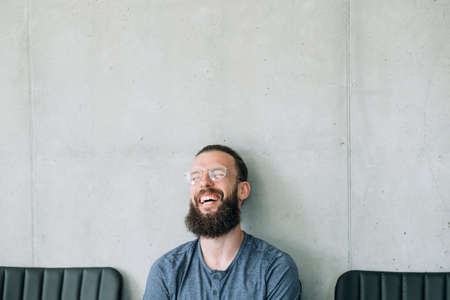 happy laughing bearded man in glasses. emotion expression Stock Photo