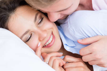 whispering words of love. couple communication and relaxed intimate leisure.