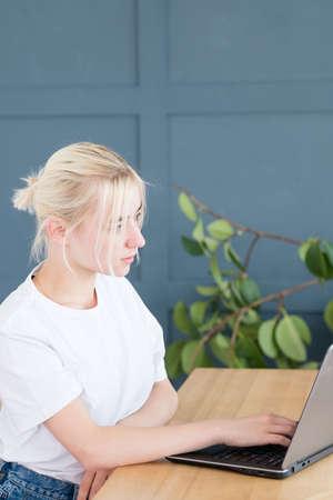 self employed woman typing on laptop. freelance work or remote job. Stockfoto