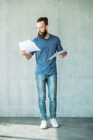man reading script on papers. focused consumed screen writer Banco de Imagens
