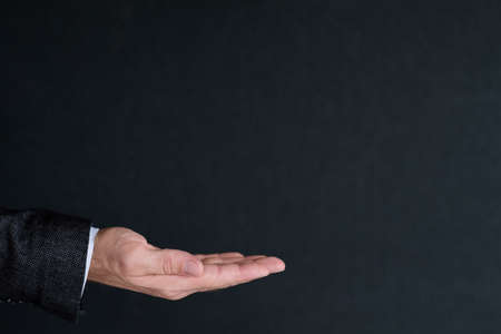 man holding invisible object in hand. empty space for advertising or product placement. Stock Photo
