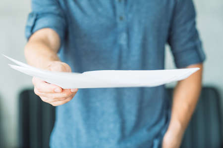man offering documents. legal agreement contract and business paperwork concept.