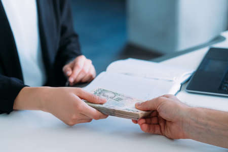 woman receiving money in office. business bribery and illegal payments Stock Photo - 113658112
