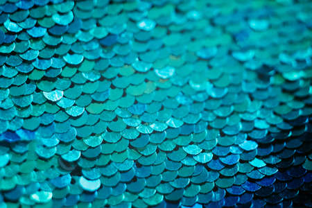 Glittering textile design. Blue sequin background. Mermaid scale concept. Stok Fotoğraf
