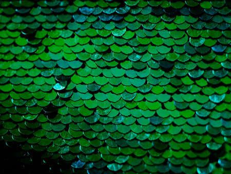 Green sequin fabric background. Mermaid scale concept.