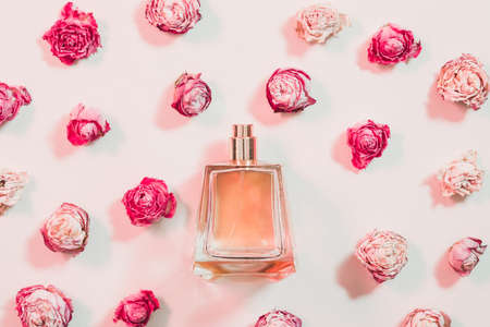 Womens day present. Perfume and flower assortment on ivory background. Reklamní fotografie