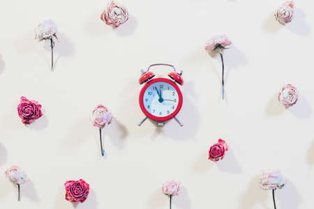 Floral pattern decor with clock. Time to celebrate concept. Rose flowers on ivory background.