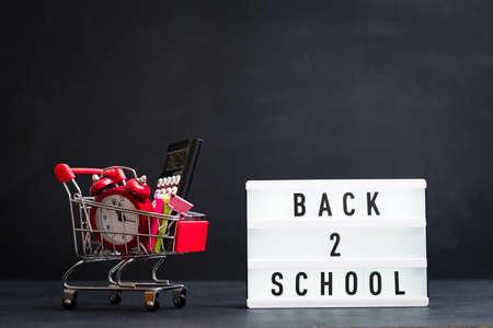 Back to school concept. Supplies bundle delivery. Blackboard background.