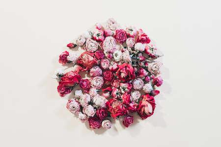 Flower present delivery. Assorted rose circle collage on ivory background. Reklamní fotografie