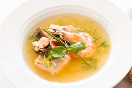 Shellfish delicacy soup background. Cooking gourmet meal concept.