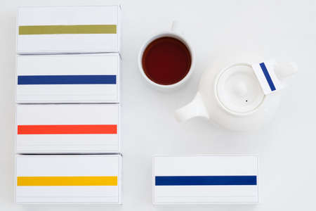 Herbal tea. Healthy habit concept. Full cup and teapot. Package layout.