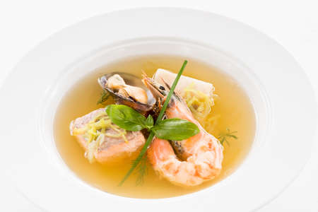 Seafood soup recipe. White plate with assorted shellfish. Stock fotó