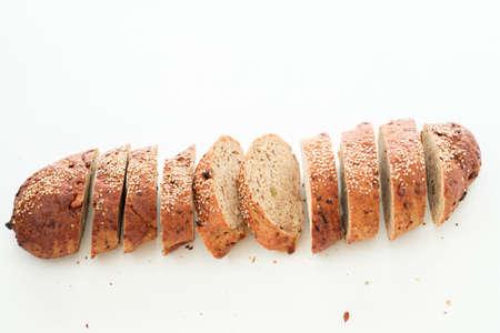 Wholegrain bread sliced. Restaurant serving. Fresh bakery simple composition.