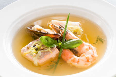 Restaurant shellfish menu. Fine cuisine. Seafood soup close up. Stock fotó