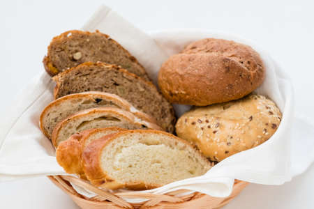 Restaurant bread serving. Hospitality concept. Basket with assorted pieces close up.