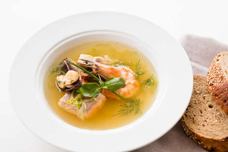 Seafood soup recipe. Home made cooking. Plate of assorted shellfish with brown bread. Stock fotó