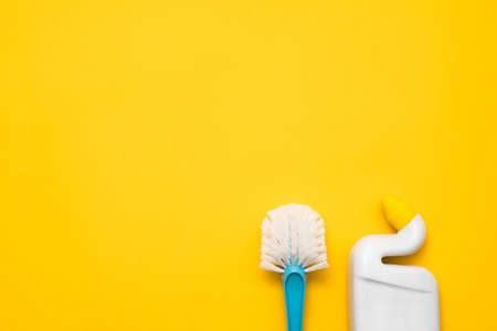 Home cleanup. Basic toilet cleaning kit. Copy space on yellow background. Stock Photo
