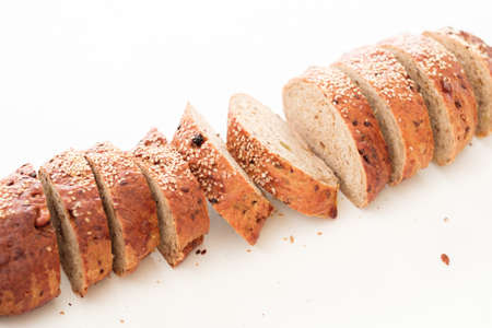 Craft wholegrain bread. Healthy home bakery. Pieces arrangement on white background. Stock fotó