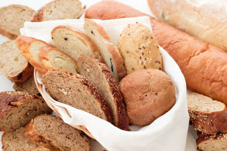 Wholesome bakery close up. Fresh bread loaf variety background. Stock Photo