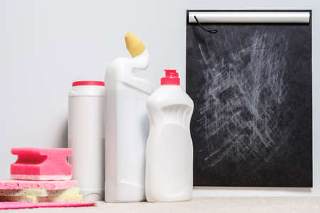 Home cleanup. Quality cleaning supplies set. Opinion and rating blackboard mockup.