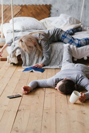 Restless night. Social networking addiction. Messy morning sleep of young couple. Stock fotó