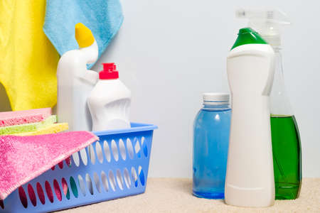 Houskeeping concept. DIY home cleanup. Cleaning supplies assortment background. Stock Photo