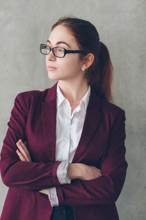 Company headhunter portrait. Confident business woman in glasses with crossed hands. Office workspace. Banco de Imagens